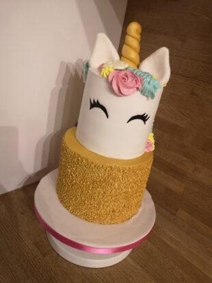 Two tier gold and rainbow unicorn birthday cake stoke on trent