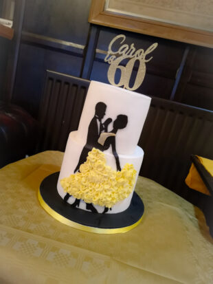 Two tier dancing themed birthday cake stoke on trent