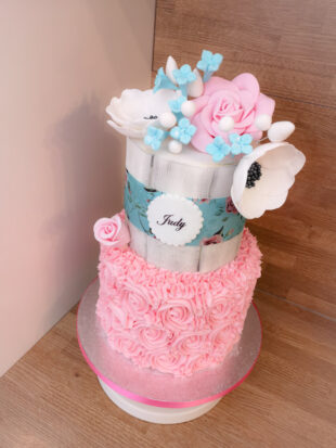 two tier flower top and butter creamed birthday cake