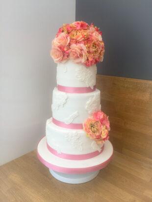 three tier wedding cake with silk flowers stoke on trent