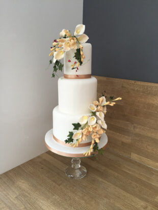 three tier classic white wedding cake, using flowers from mums wedding cake
