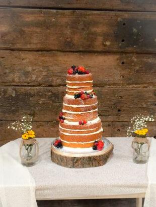 three tier naked wedding cake with fresh fruit