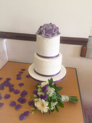 Two tier round wedding cake with hand made roses