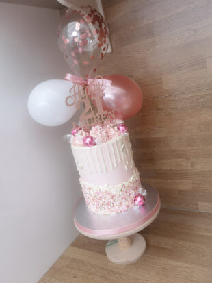 Blush Pink and rose gold drizzle balloon bunting cake