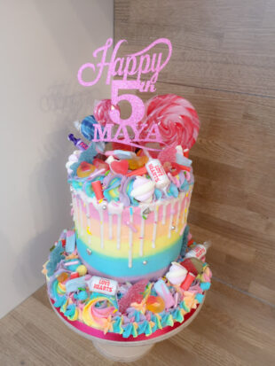 Rainbow buttercream sweet overload drizzle drip birthday cake with cake topper